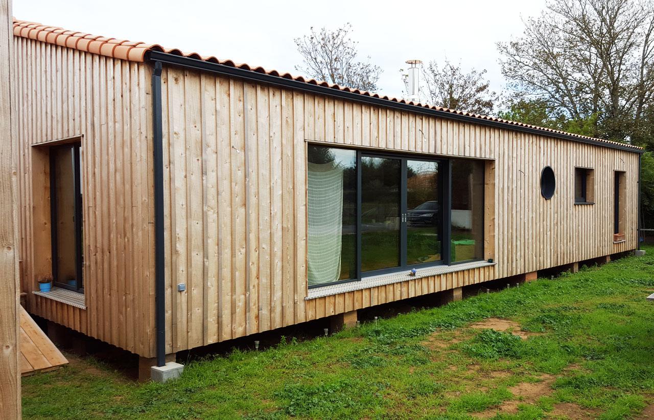 Extension maison bois toit plat for Agrandissement maison ossature bois toit plat